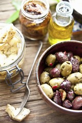 Italian antipasti: marinated olives, artichoke hearts and dried tomatoes