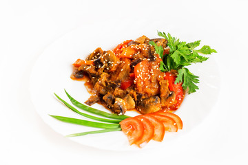 Plate of vegetable ragout with mushrooms isolated at white background.