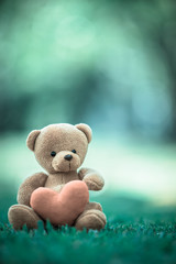bear doll and red heart with dramatic tone