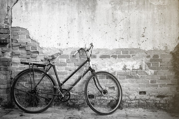Bicycles on background old wall.