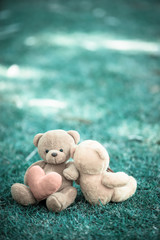 two bear dolls and red heart with dramatic tone