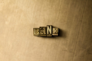 BANK - close-up of grungy vintage typeset word on metal backdrop. Royalty free stock illustration.  Can be used for online banner ads and direct mail.