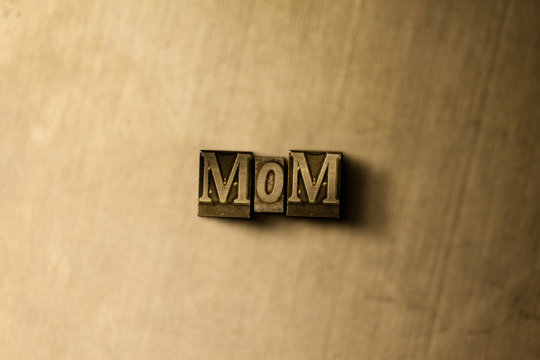 MOM - close-up of grungy vintage typeset word on metal backdrop. Royalty free stock illustration.  Can be used for online banner ads and direct mail.