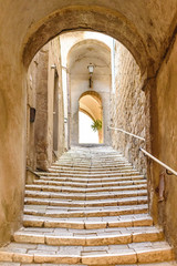 old stone steps and arch in the medieval village, Pitigliano, tuscany, italy