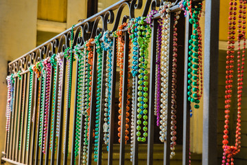 Close-up of Mardi Gras Beads Hanging from a Balcony in New Orleans