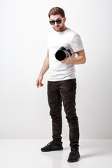 young successful professional photographer in t-shirt use digita