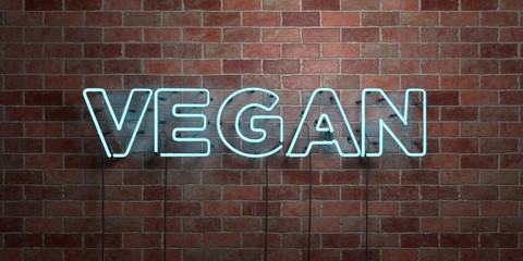 VEGAN - fluorescent Neon tube Sign on brickwork - Front view - 3D rendered royalty free stock picture. Can be used for online banner ads and direct mailers..
