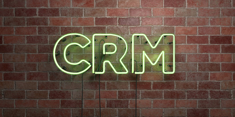 CRM - fluorescent Neon tube Sign on brickwork - Front view - 3D rendered royalty free stock picture. Can be used for online banner ads and direct mailers..