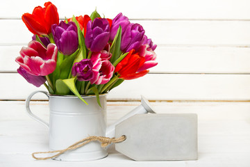 Tulip bouquet on  wooden background, copy space