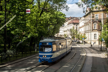 Krakow Poland old tram carriages transportation train downtown area historic buildings