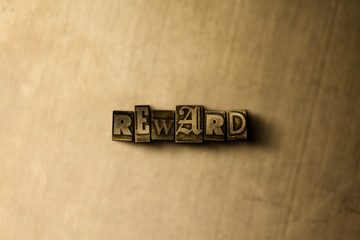 REWARD - close-up of grungy vintage typeset word on metal backdrop. Royalty free stock illustration.  Can be used for online banner ads and direct mail.