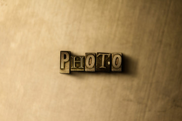 PHOTO - close-up of grungy vintage typeset word on metal backdrop. Royalty free stock illustration.  Can be used for online banner ads and direct mail.
