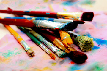 Artistic paintbrushes and palette - colorful world