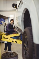 Mechanic examining a car