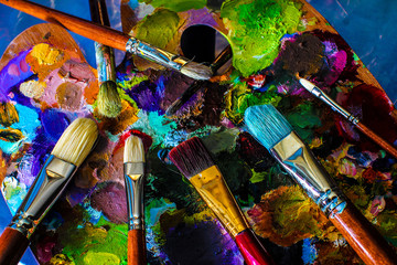 Artistic paintbrushes and palette