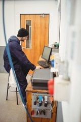 Mechanic working on personal computer