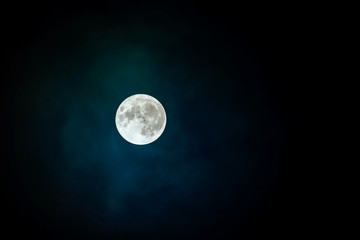 Full super moon over dark black sky at night. Full moon background. Photo Stock