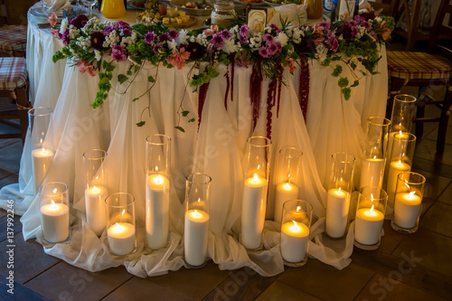 Many Candles In Vases Around The Banquet Table Stock Photo And