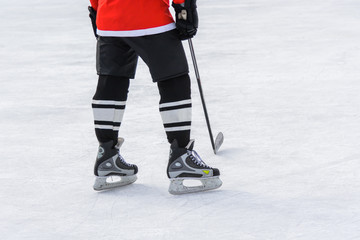 hockey player with a stick standing on ice
