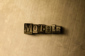 MOTHER - close-up of grungy vintage typeset word on metal backdrop. Royalty free stock illustration.  Can be used for online banner ads and direct mail.