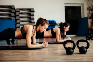 Fitness Girls Doing Plank yoga challenge