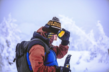 Side view of man preparing for skiing