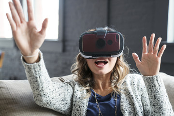 Businesswoman wearing virtual reality simulator in office