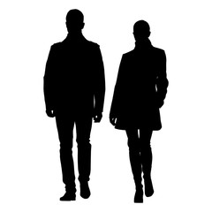 Man and woman walking side by side dressed in coats. Vector silhouette of young couple well dressed people