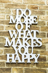 Do More Of What Makes You Happy Motivation Quote on a wall