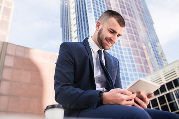 young businessman using a tablet computer