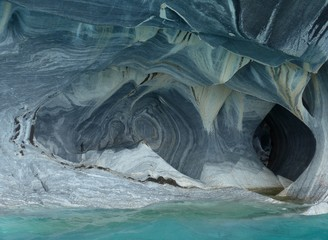 Unique colors and patterns on the Marble cliffs and cavers eroded by the turquoise waters of Lago General Carrera.