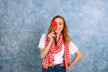 attractive woman with candy near her face