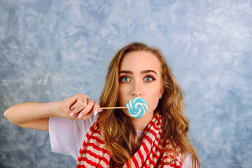 portrait of pretty female with candy