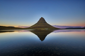 Reflections of Kirkjufell during sunset with clear sky. one of the spot place at iceland