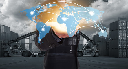 Global network coverage world map on hand of businessman, Industrial Container Cargo yard for Logistics Import Export. (Elements of this image furnished by NASA)