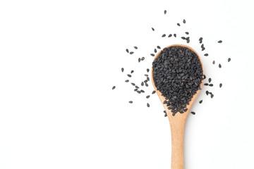 Black sesame seeds in wooden spoon