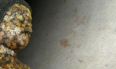 Ancient golden buddha, The ancient golden buddha statue or ancient golden buddha image on rock texture background