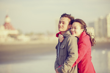 Happy young couple enjoy being at the beach