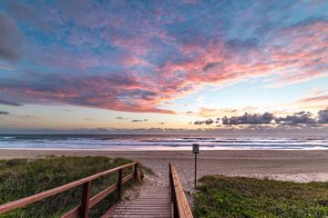 Epic beach landscape with sunrise sky and beach entrance