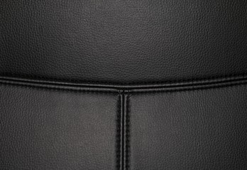 Black leather texture background surface with seam. Macro shot.