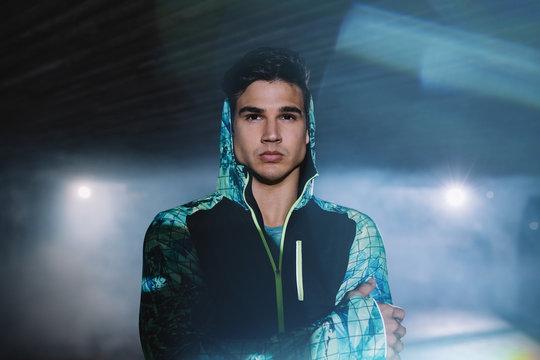Urban runner standing on the street at night