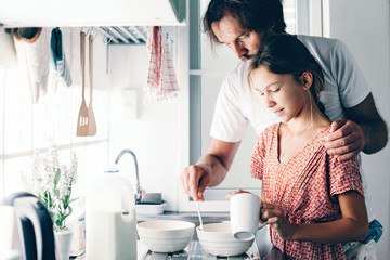 Child baking with parent