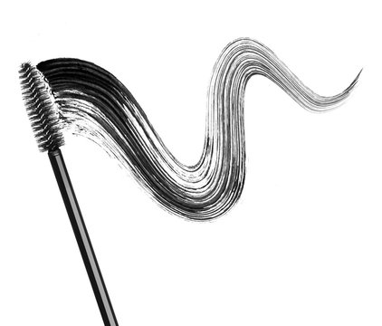 Stroke of black mascara with applicator brush close-up, isolated on white background