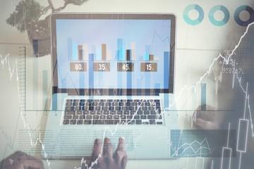 Business executives using laptop
