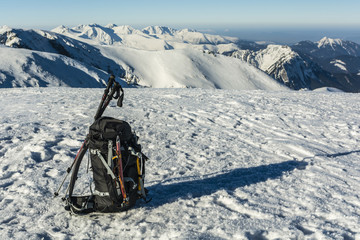 Backpack with the referenced ice axes and trekking poles.