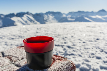 Cup of hot tea on a table with a boundary marker.