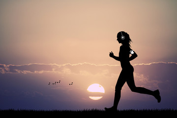 woman runs with headphones for music