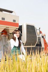 young asian woman agronomist in golden field