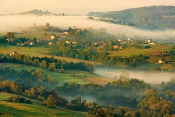 Beautiful autumn woods landscape taken in polish Beskidy mountain, rays and amazing inversion, Ochodzita