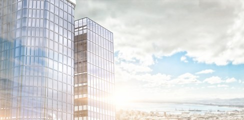 Composite image of low angle view of glass building